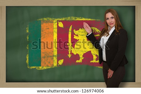 Successful, beautiful and confident woman showing flag of srilanka on blackboard for marketing research, presentation and tourist advertising - stock photo
