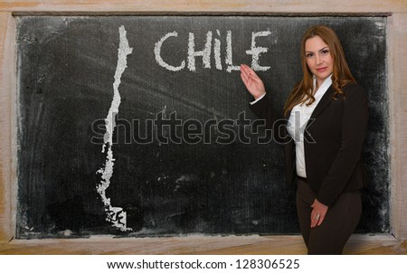 Successful, beautiful and confident young woman showing map of chile on blackboard for presentation, marketing research and tourist advertising