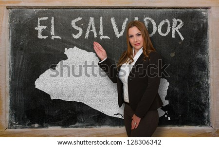 Successful, beautiful and confident young woman showing map of el salvador on blackboard for presentation, marketing research and tourist advertising - stock photo