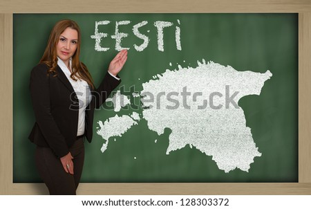 Successful, beautiful and confident young woman showing map of estonia on blackboard for presentation, marketing research and tourist advertising - stock photo