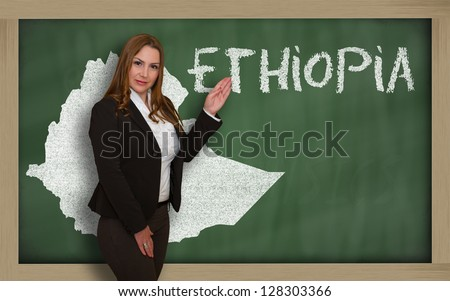 Successful, beautiful and confident young woman showing map of ethiopia on blackboard for presentation, marketing research and tourist advertising - stock photo