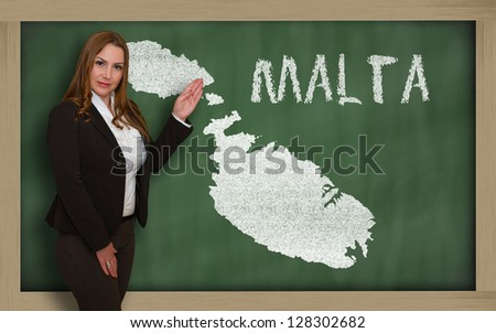 Successful, beautiful and confident young woman showing map of malta on blackboard for presentation, marketing research and tourist advertising - stock photo