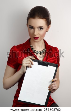 Successful beautiful lady. Portrait of the waist perfect woman. Stylish hair dress silver expensive jewelry necklace, red blouse shoulders, white background, red lips, hands holding white paper folder - stock photo