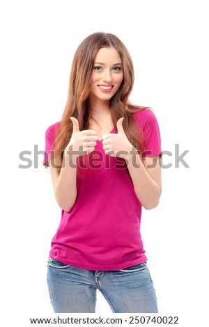 Successful beauty. Beautiful young smiling woman looking at camera and showing her thumbs up while standing isolated on white - stock photo