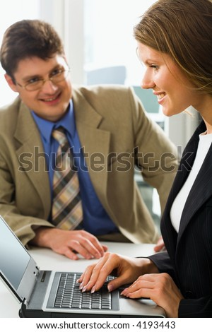 Successful business coach and his young beautiful female learner