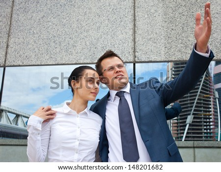 Successful business couple in the lobby of an office center