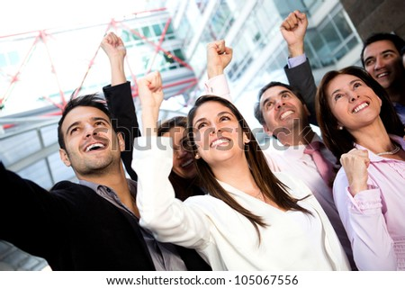 Successful business group celebrating their triumph with arms up - stock photo