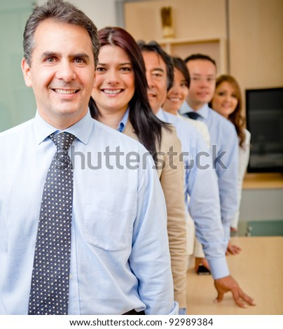 Successful business group in a row at the office - stock photo