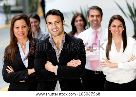Successful business group looking confident and smiling