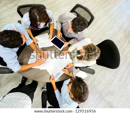 Successful business group working at the office - stock photo