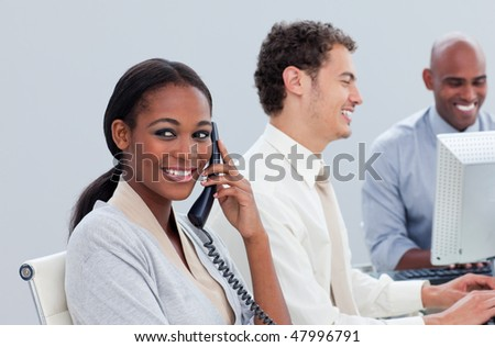 Successful business group working hard in the office in a company - stock photo