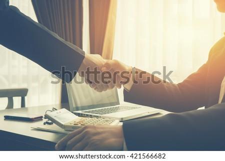 Successful business,Handshake,Business man  holding hands closeup,selective focus,Vintage tone,copy space - stock photo