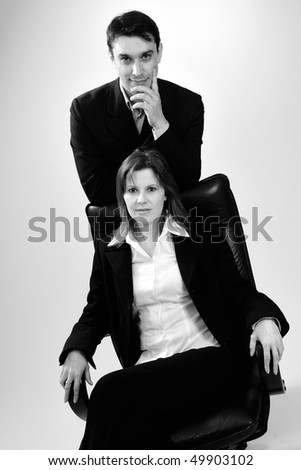 successful business man and woman expressing partnership - stock photo