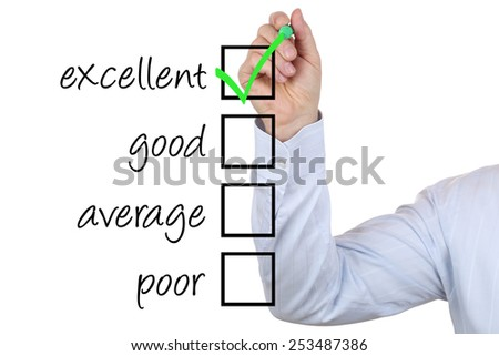 Successful business man choosing excellent quality by ticking a box - stock photo