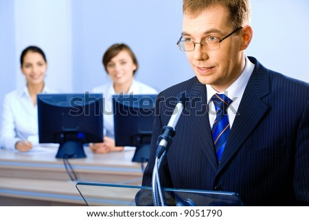 Successful business man delivers oneself of a speech at a conference