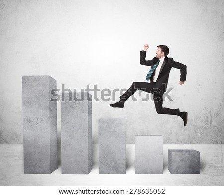 Successful business man jumping over charts on background concept - stock photo