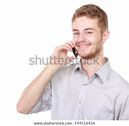 Successful business man talking on the phone isolated over white background - stock photo