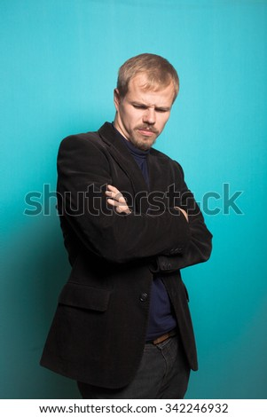 successful business man thinking over a problem, with a beard and mustache, office style studio photo isolated on a blue background - stock photo