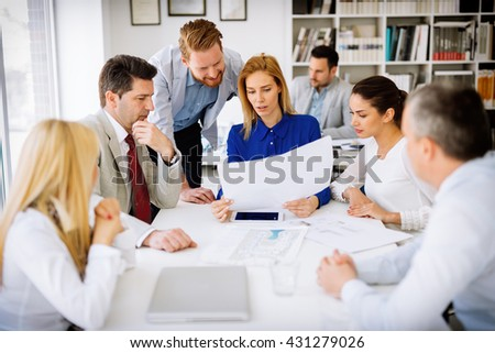 Successful business partners brainstorming in office - stock photo