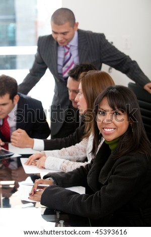 Successful business people at a corporate meeting - stock photo