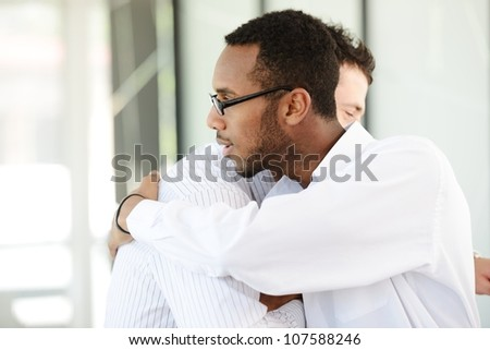 Successful business people hand shaking after great deal - stock photo