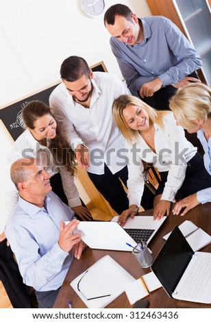 Successful business people having a break together at the office  - stock photo
