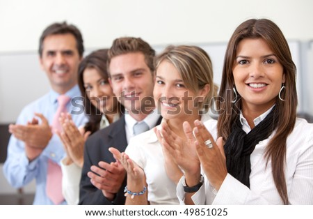 Successful business team at the office applauding - stock photo