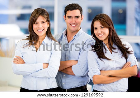 Successful business team at the office with arms crossed - stock photo