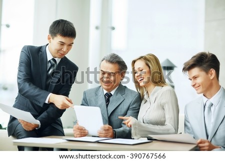 successful business team discussing the plan of work of the comp - stock photo