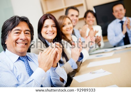Successful business team in a meeting applauding - stock photo