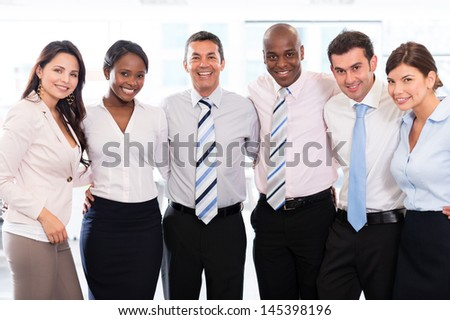 Successful business team looking very happy at the office
