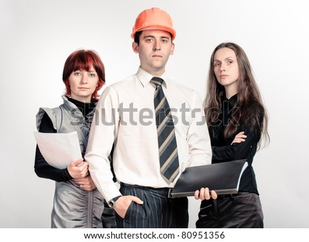 Successful business team of three young people. Posing