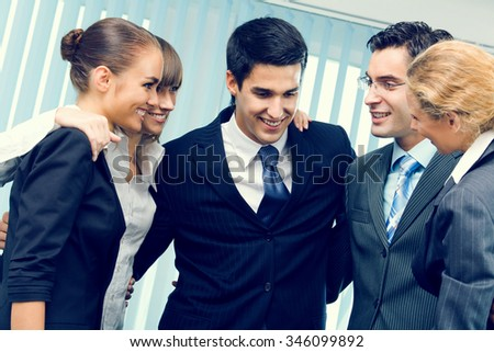 Successful business-team planning or brainstorming at office - stock photo