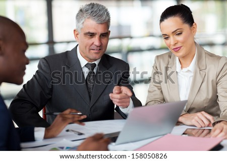 successful business team planning work on laptop - stock photo
