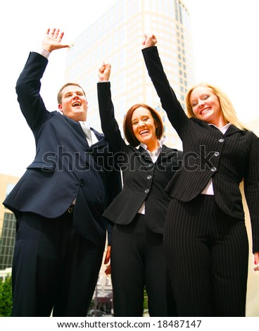 successful business team raising hands and smiling as if they have achieved great success