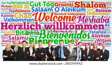 Successful business team saying welcome in tag cloud with many languages - stock photo