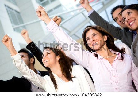 Successful business team with arms up and smiling