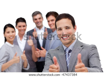 Successful business team with thumbs up against a white background