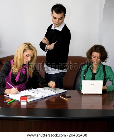 Successful business team working over a laptop computer and documents