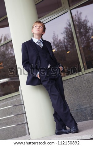 Successful business teen in street setting, outdoor