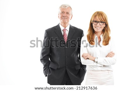 Successful business woman and businessman standing against white background. Sales team. - stock photo