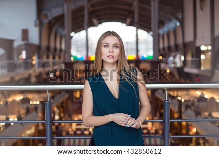 successful business woman. Beautiful young female executive in an urban setting - stock photo