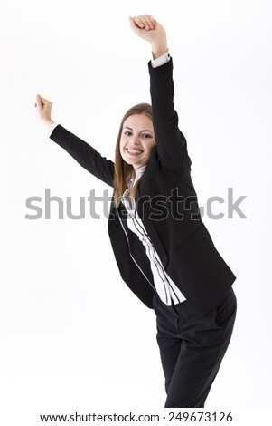 Successful business woman celebrating and dancing for joy. Caucasian brunette female model. Isolated on white background.
