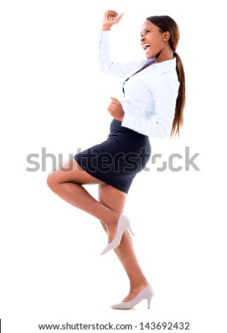Successful business woman celebrating - isolated over white background - stock photo