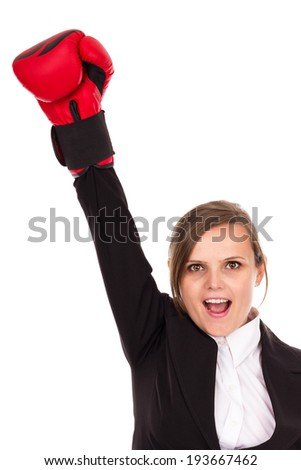 Successful business woman celebrating with one arm in air wearing boxing gloves - business concept-isolated over white background - stock photo