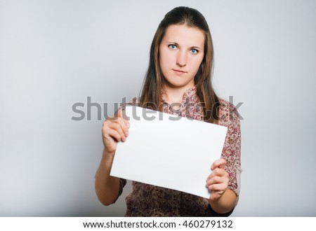Successful business woman holding a sheet of paper for your text on background