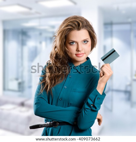 successful business woman holding credit card  in hand - stock photo