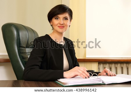 successful business woman in the office - stock photo