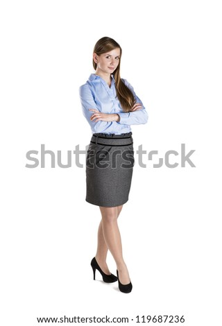 Successful business woman is standing on isolated background. - stock photo