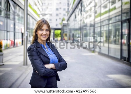 Successful business woman looking confident and smiling. - stock photo
